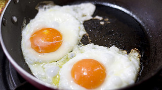stock photo of fried eggs in pan